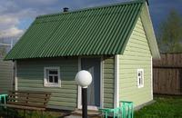 Отделка фасада дачного дома сайдингом