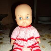 Одела куклу в детский сад.